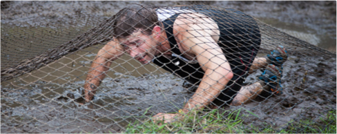 Photo of a man crawling under a net