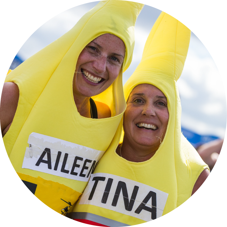 Photo of two women dressed as bananas
