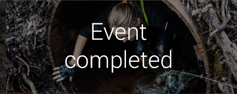 Girl crawling out of a tunnel with 'Event completed' in white text